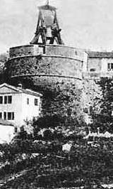 An old photo of the Bell on the Malipiero Tower